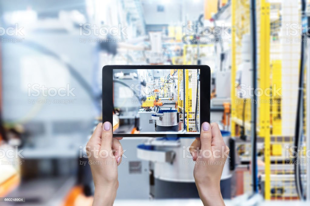 Robotic machines & digital tablet stock photo