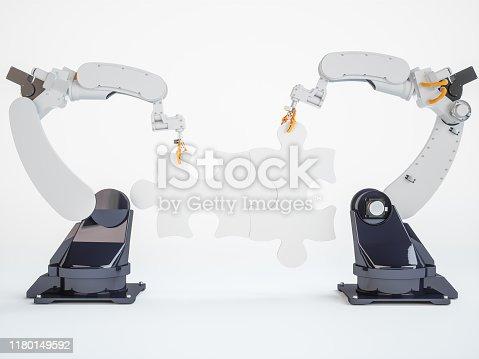 Robotic Manipulators Holding The Piece Of Jigsaw Puzzle
