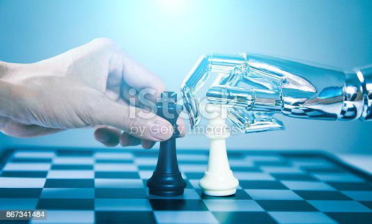 istock Robotic playing chess with human 867341484