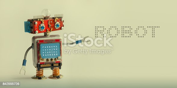 istock Robotic technology concept. IT specialist cyborg toy, smiley red head blue monitor body. Robot digital message on beige canvas. copy space photo 842555726