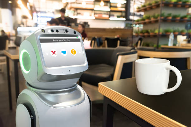 Robotics Trends technology business concept. Autonomous personal assistant personal service robot for order menu food in restaurant and cup of coffee. stock photo