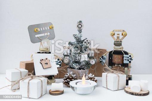 istock Robots are near christmas tree. 1069304494