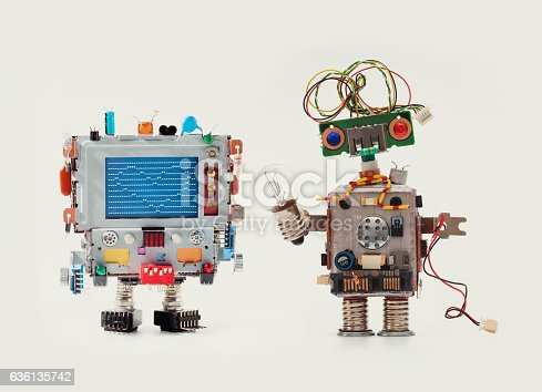 istock Robots friends Funny man mechanism with monitor head, love heart 636135742