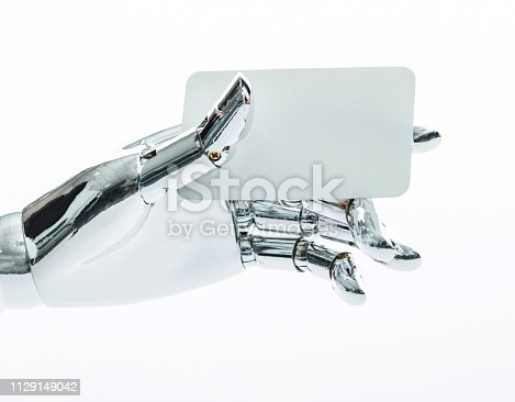 910163152 istock photo Robot's hand holding a empty business card 1129149042