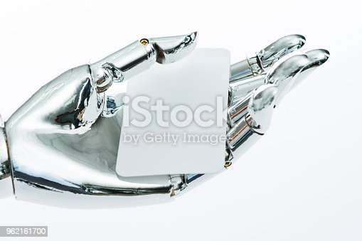 istock Robot's hand holding a empty business card 962161700