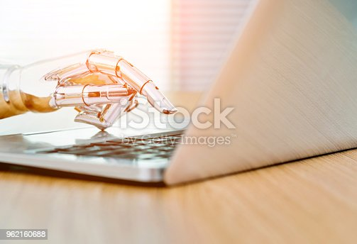 istock Robot's hand typing on keyboard 962160688