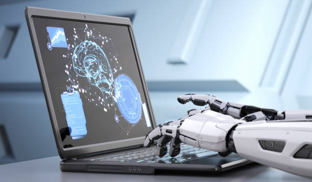 Robot's hands typing on keyboard stock photo