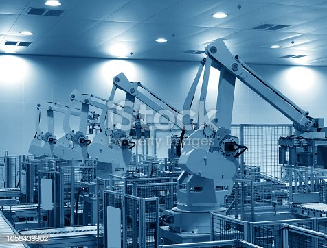 846859964 istock photo robots in a car factory 1058439902