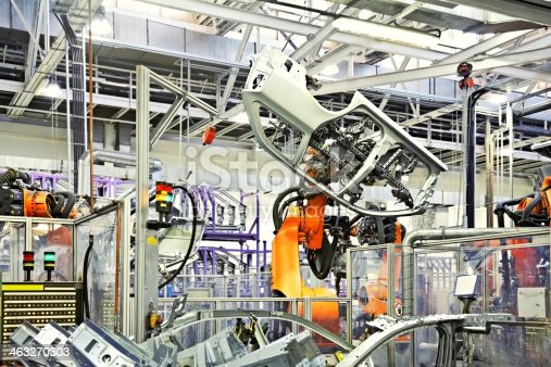 118429320 istock photo robots in a car factory 463270303