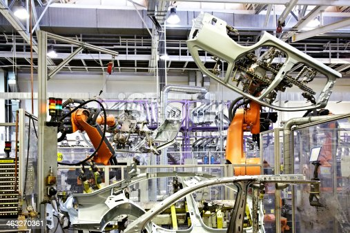 182463664 istock photo robots in a car factory 463270361