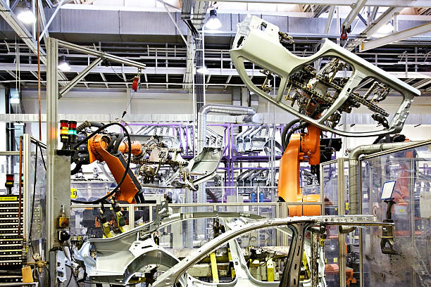 robots in a car factory stock photo