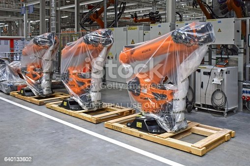 1069360792 istock photo Robots in the car factory 640133602