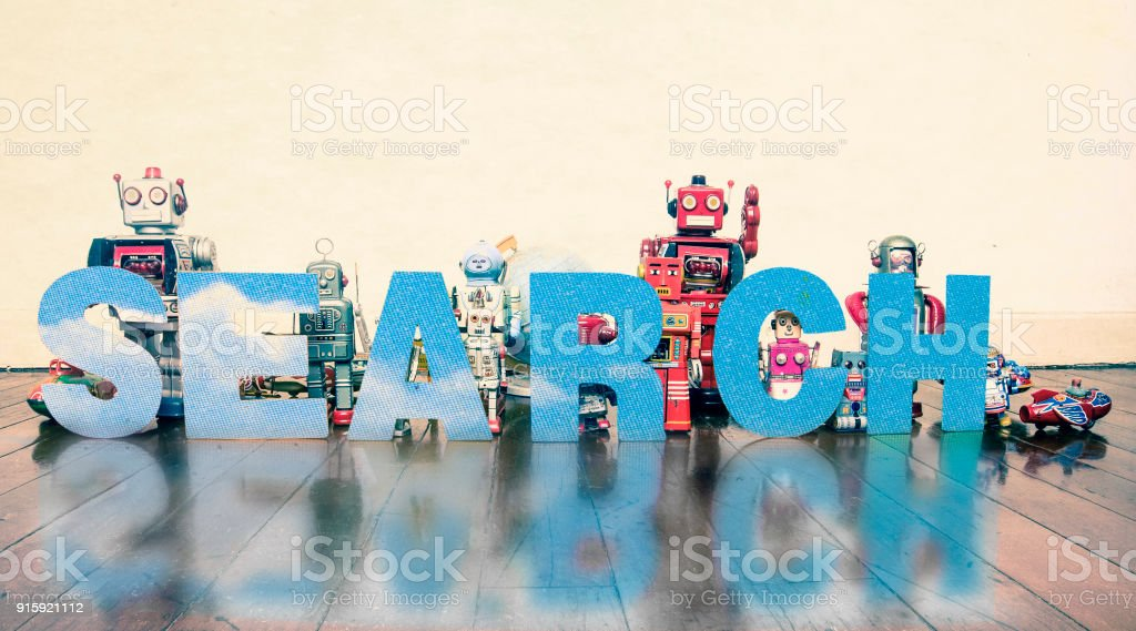 robots on old wooden floor with the word search stock photo