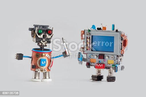 istock Robots repair service concept. Handyman mechanic worker with screw driver 636135708