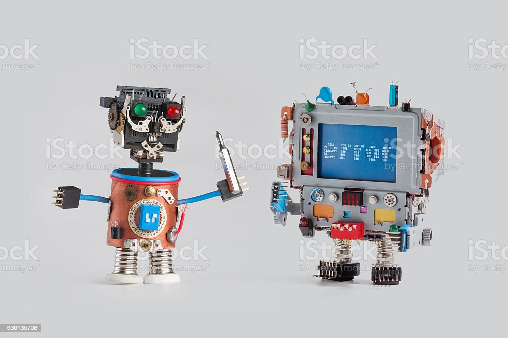 Robots repair service concept. Handyman mechanic worker with screw driver stock photo