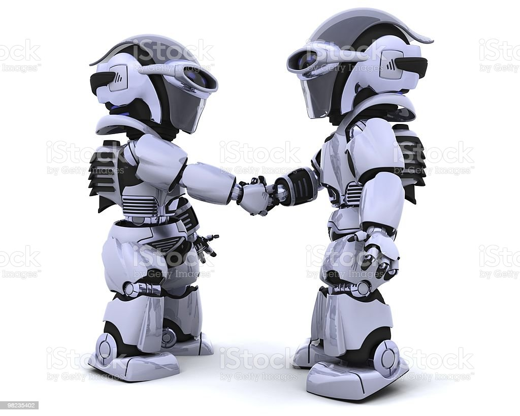 robots shaking hands royalty-free stock photo
