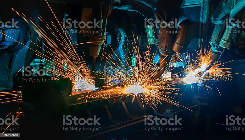 Robots welding  automotive part. stock photo
