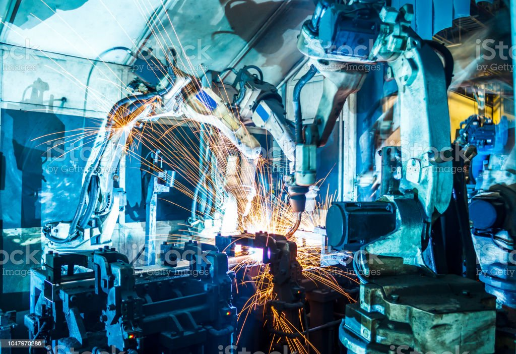 Robots welding in a car factory stock photo