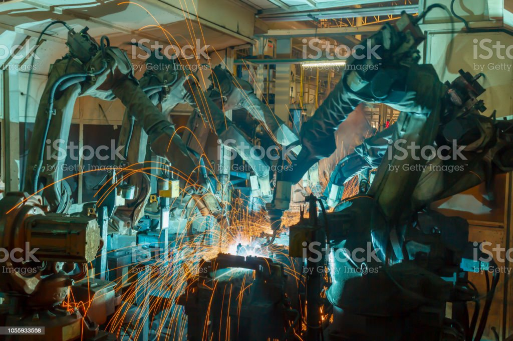 Robots welding in a car factory. stock photo