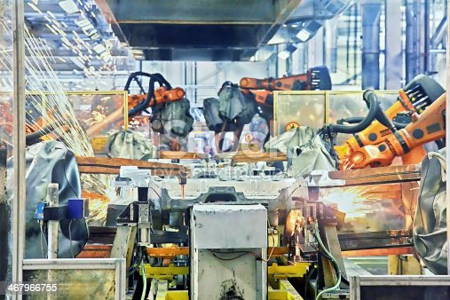156642859 istock photo robots welding in a car factory 467966755
