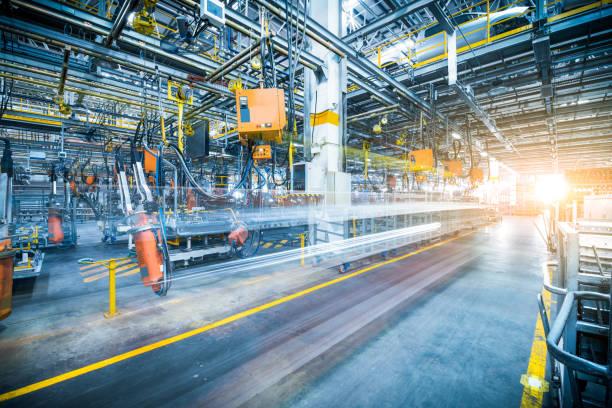 robots welding in a car factory robots welding in a car factory manufacturing stock pictures, royalty-free photos & images