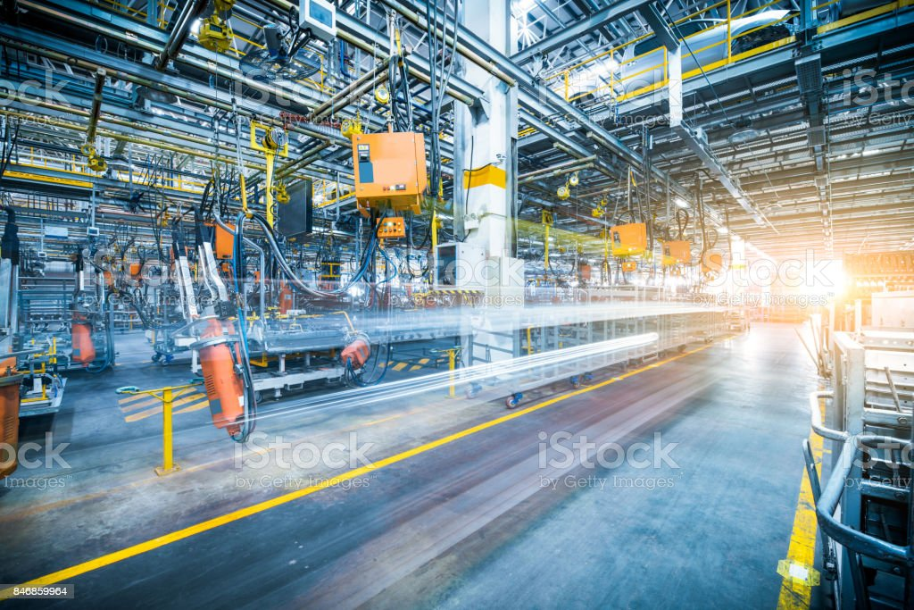 robots welding in a car factory - foto stock