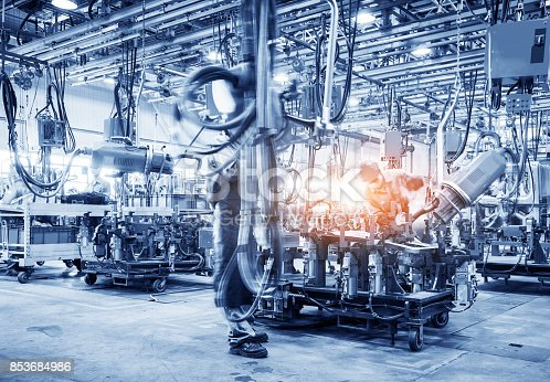 846859964 istock photo robots welding in a car factory 853684986