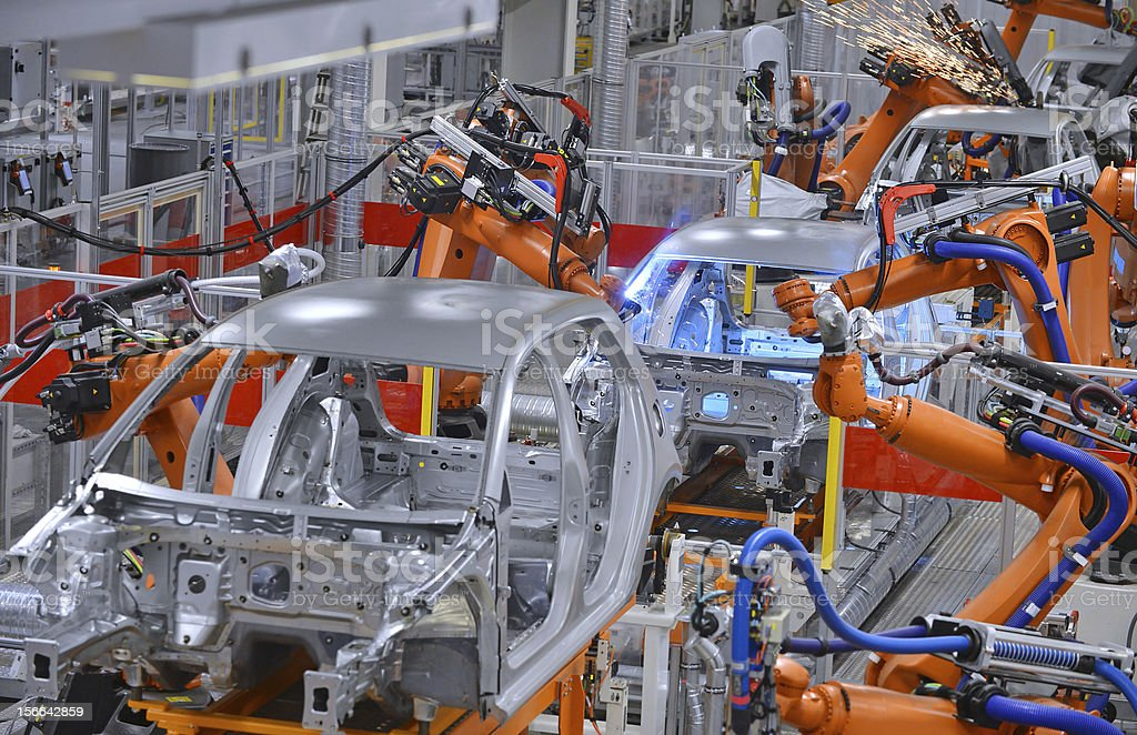 robots welding in factory robots welding in an automobile factory Automated Stock Photo