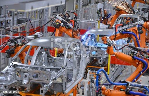 156642859 istock photo robots welding in factory 156642859