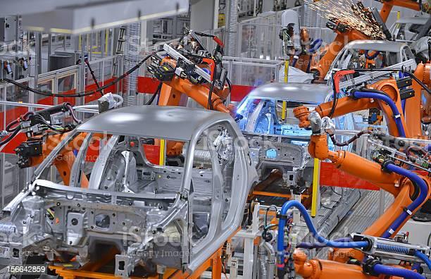 Robots Welding In Factory Stock Photo - Download Image Now