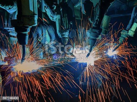 156642859 istock photo Robots welding in factory 597246400