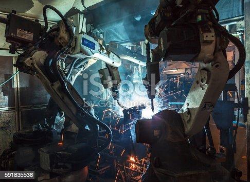 istock Robots welding industry 591835536