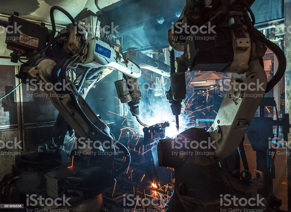 Robots welding industry stock photo