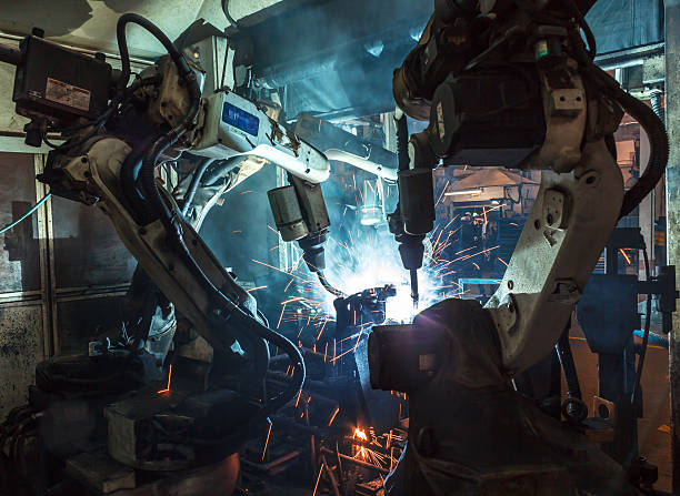robots welding industry - robotics manufacturing stock photos and pictures
