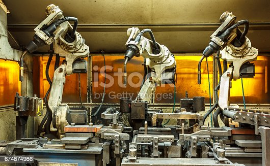 istock Robots welding team in the automotive parts industry 674874986