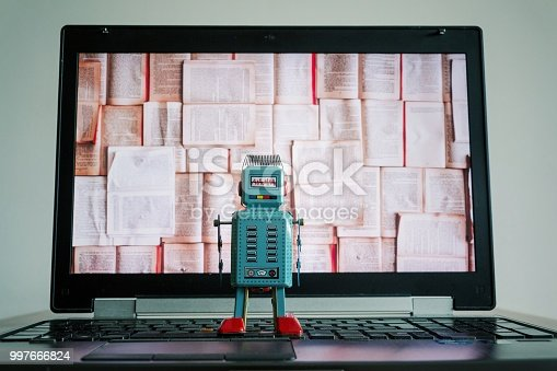 istock Robots with books screen, big data and deep learning concept 997666824