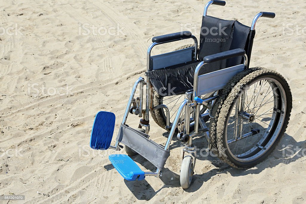robust wheelchair made of aluminum with special wheels stock photo