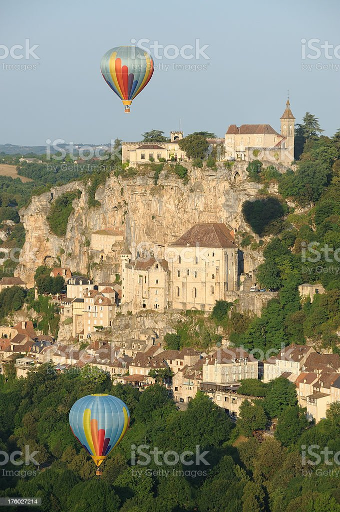 Rocamadour and hot-air balloons stock photo