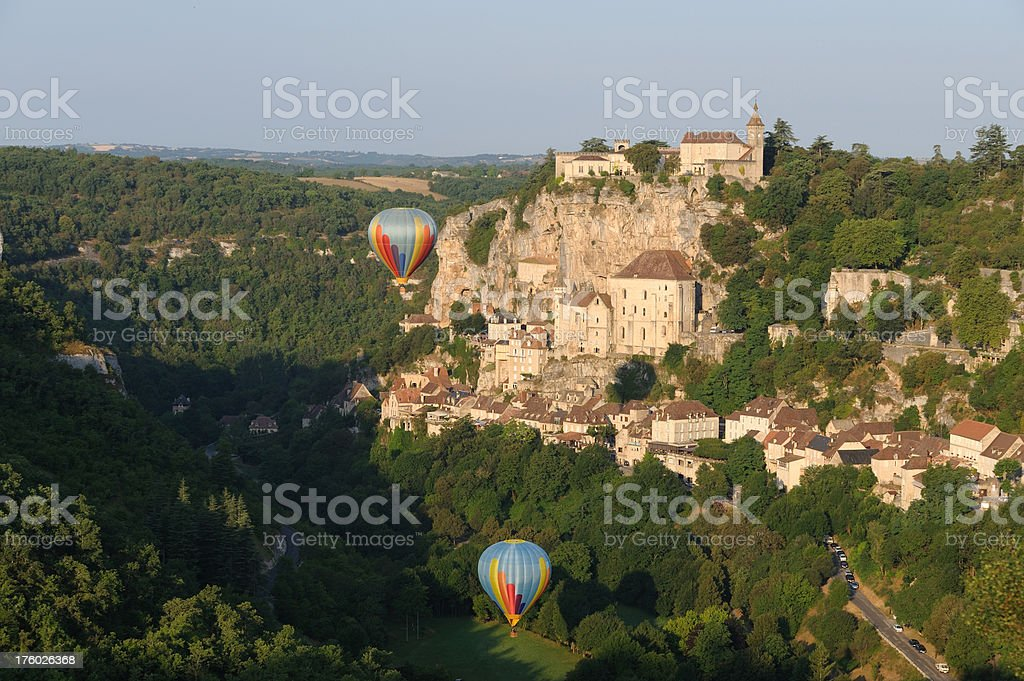 Rocamadour and two hot-air balloons stock photo