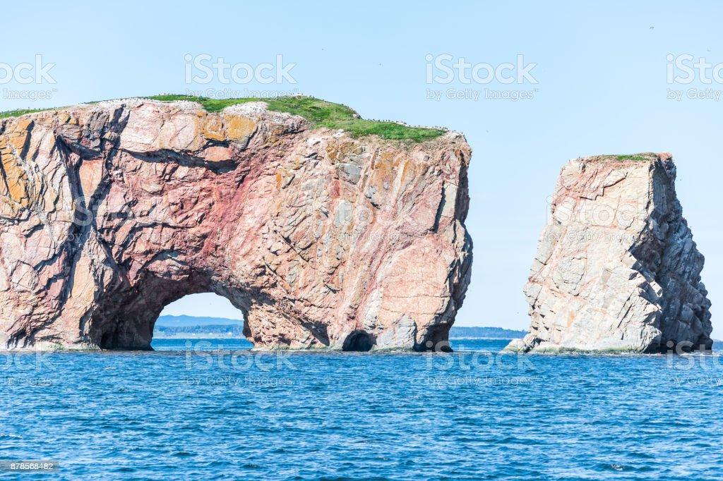Rocher Perce rock in Gaspe Peninsula, Quebec, Gaspesie region closeup with blue water stock photo