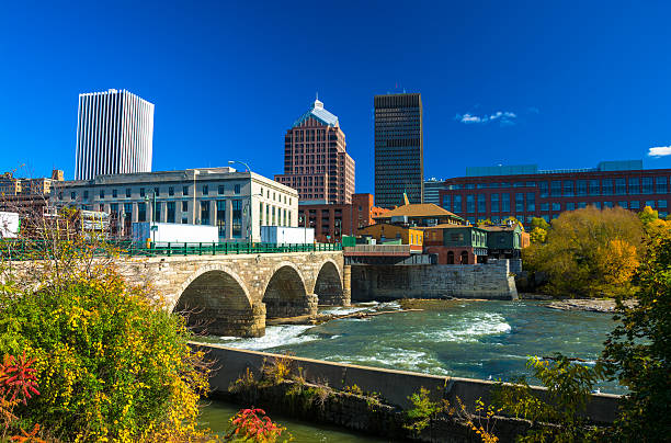 rochester skyline with stone bridge and river - rochester ny skyline stock photos and pictures