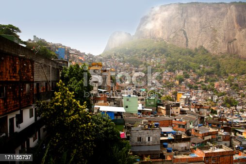 Photo taken from inside Rocinha favela in Rio de Janeiro. This favela is built on a steep hillside and is considered the largest in Brazil. It is fairly well developed, with decent sanitation, electricity and plumbing. This favela is slated to be pacified in time for the 2014 World Cup Soccer and 2016 Summer Olympics.See more favela photos in Urban scape lightbox below.