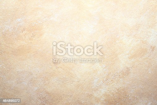 istock rock abstract beige wall background 464895072