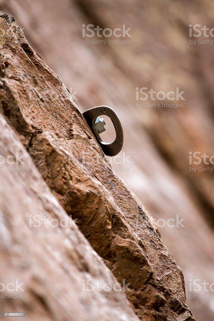 rock anchor climbing stock photo