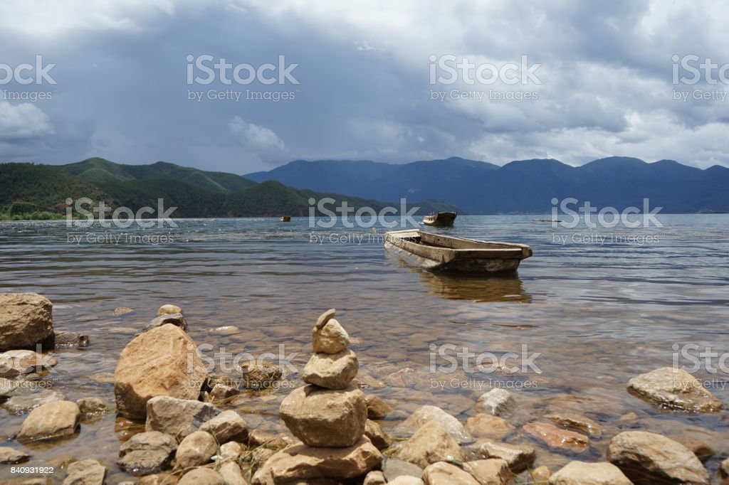 Rock And Boat stock photo