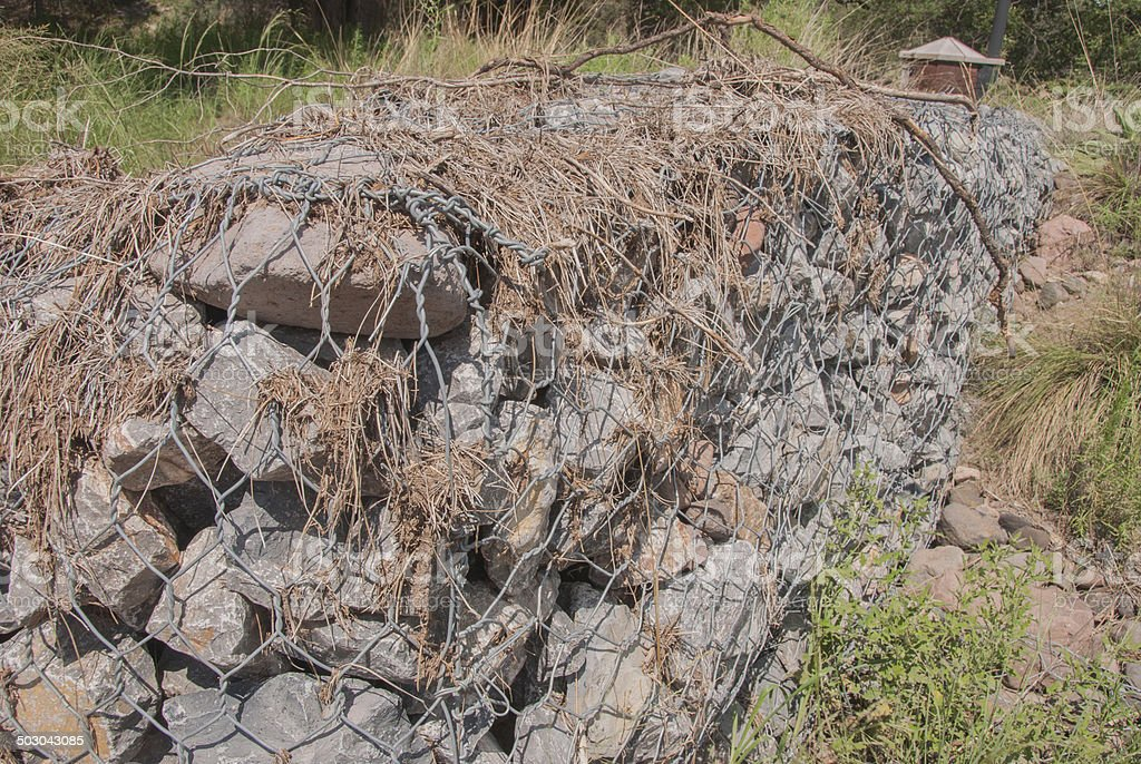Rock and Chicken Wire Barrier Against Flooding stock photo
