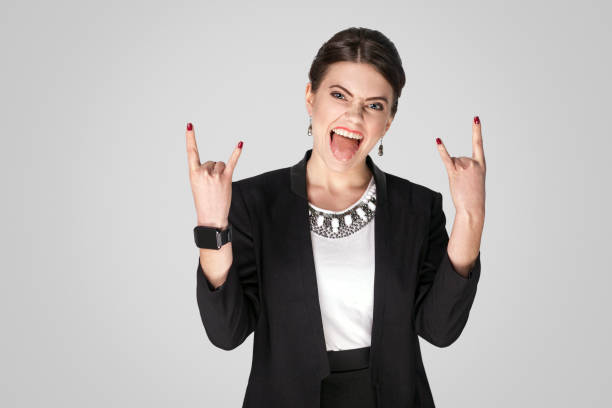 rock and roll! businesswoman showing rock sign - rock musician stock pictures, royalty-free photos & images