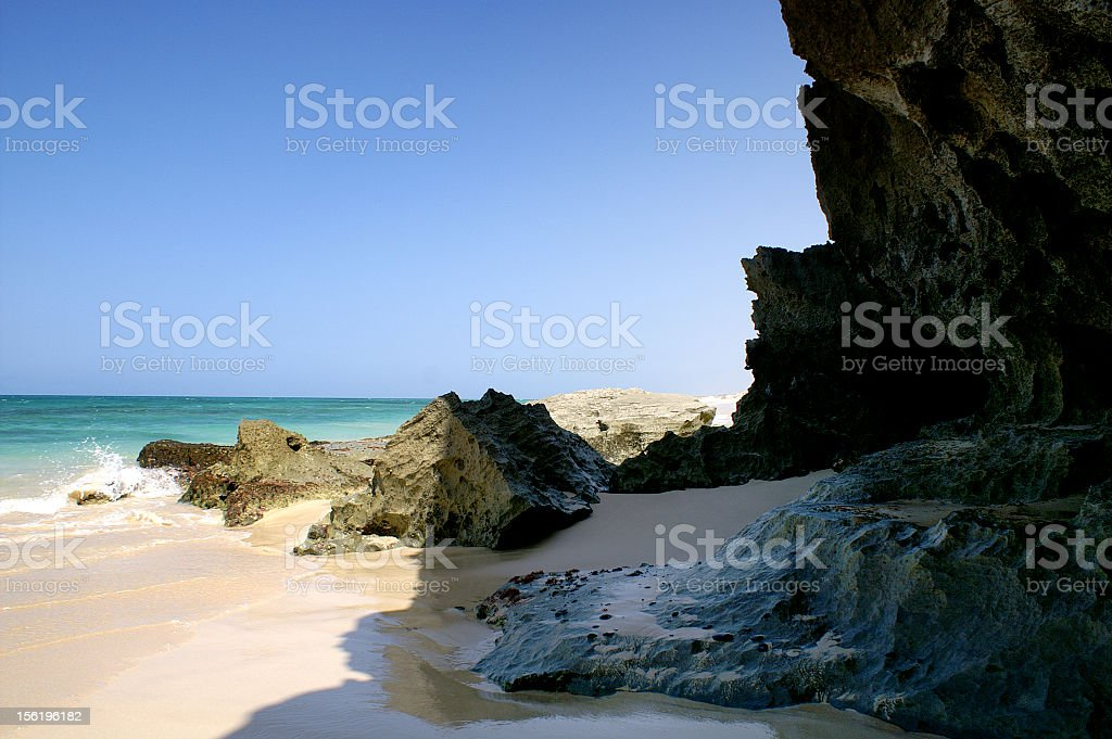 Rock and sand mixture off the coast of Cape Verde royalty-free stock photo