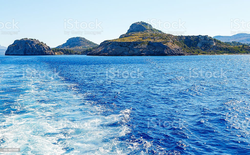 Rock Anthony Quinn Bay view from the sea stock photo