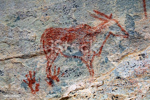 istock Rock Art Painting in Tsodilo Hills, Botswana. Paintings are attributed to the San People. 1064258052
